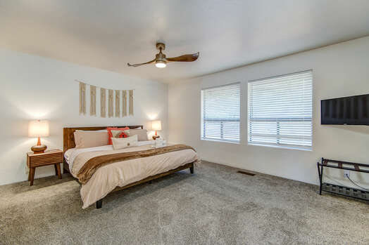 Spacious Master Bedroom with a King Bed and Smart TV
