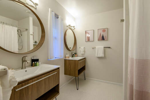 En Suite with Separate Vanities and a Tub/Shower Combo