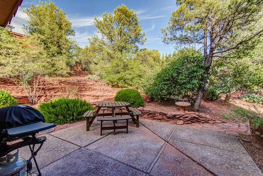 Landscaped Yard with Patio Seating and a Gas BBQ