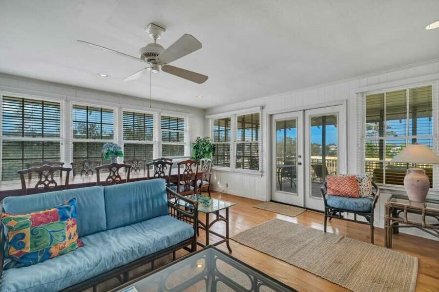 Open Plan Living Area with Access to Screened in Porch overlooking the Bayou