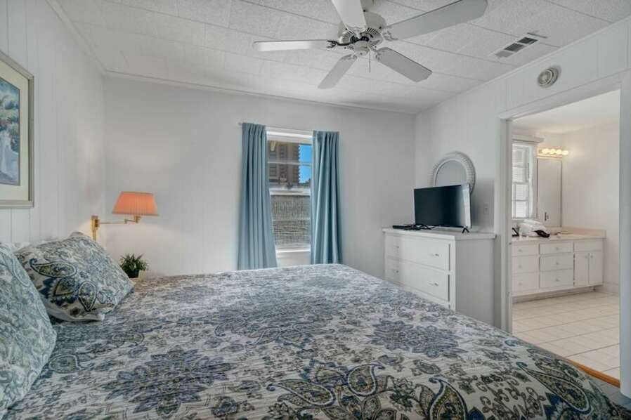 Master Bedroom with a King Size Bed and Full Size EnSuite Bathroom with Double Sink Vanity