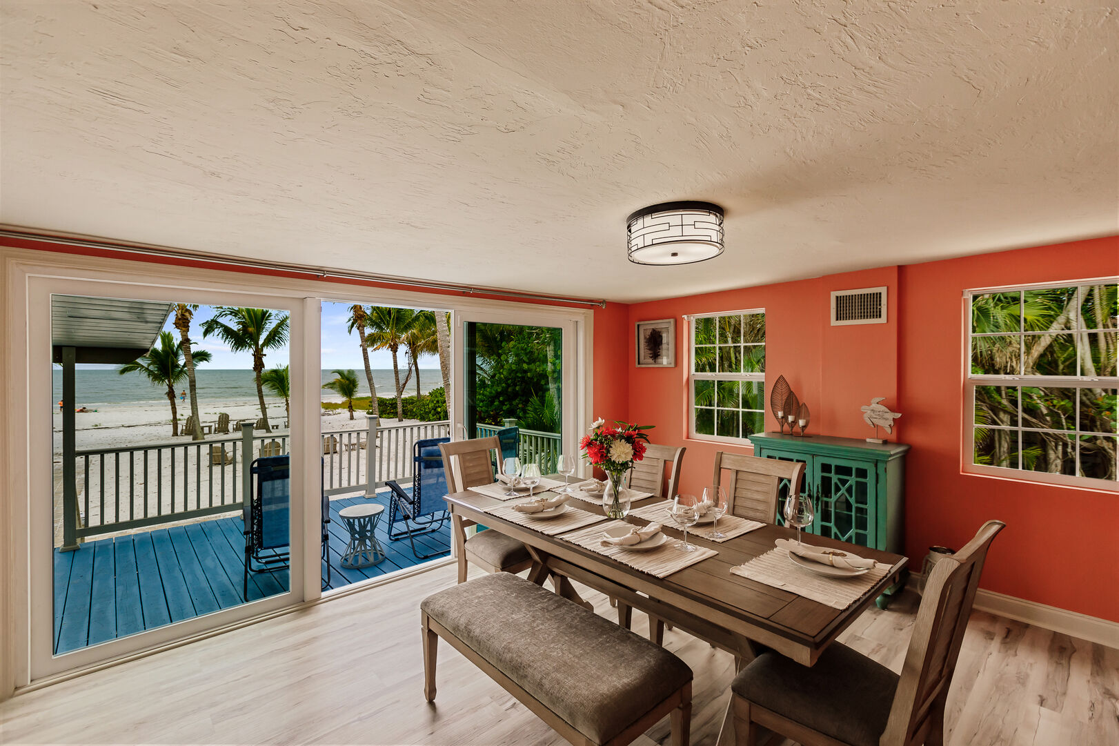Dining Room Area and Back Deck View of Beach Private Beach House Rental in Florida