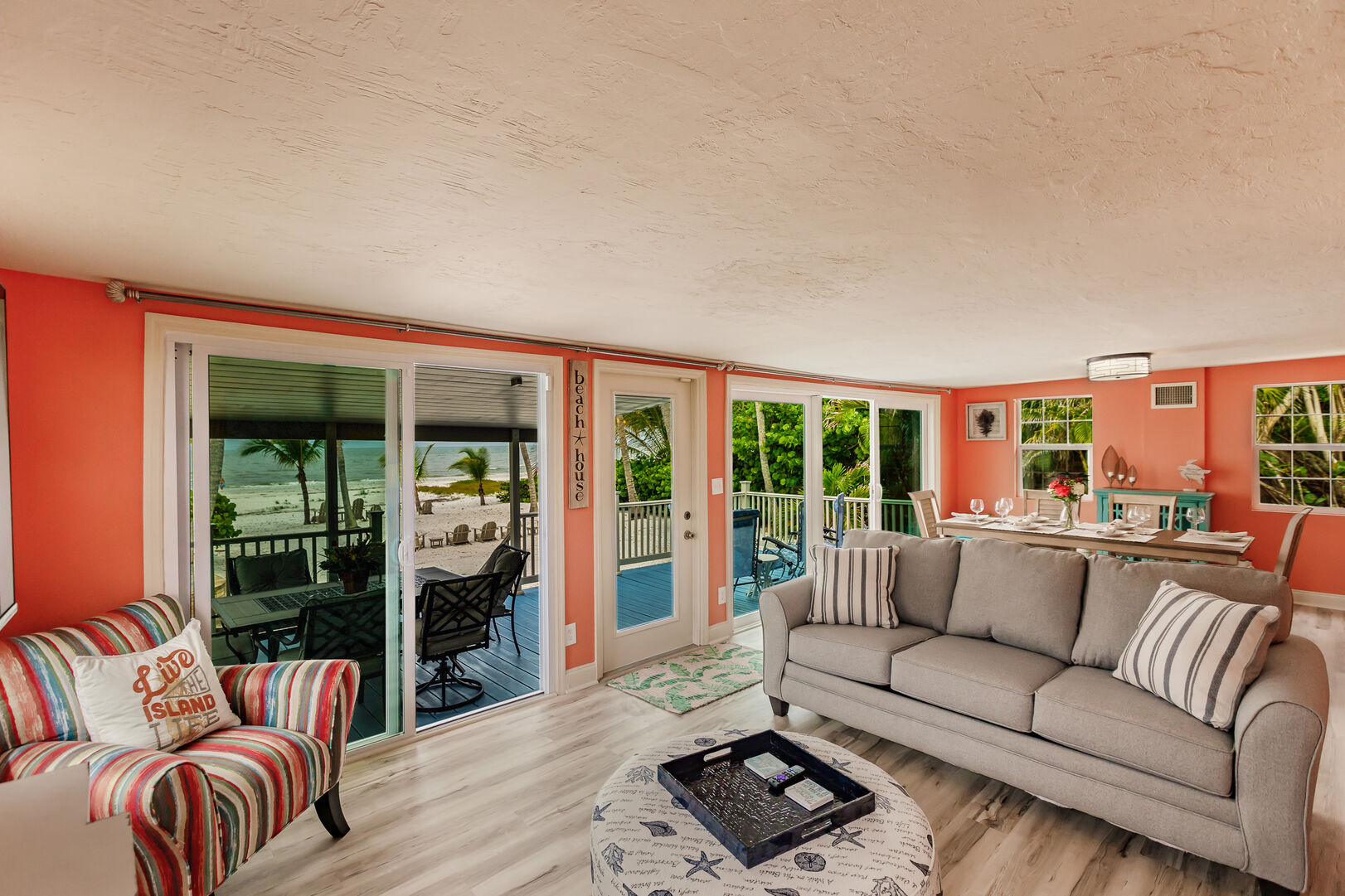 Living Room and Back Deck View of Beach Private Beach House Rental in Florida