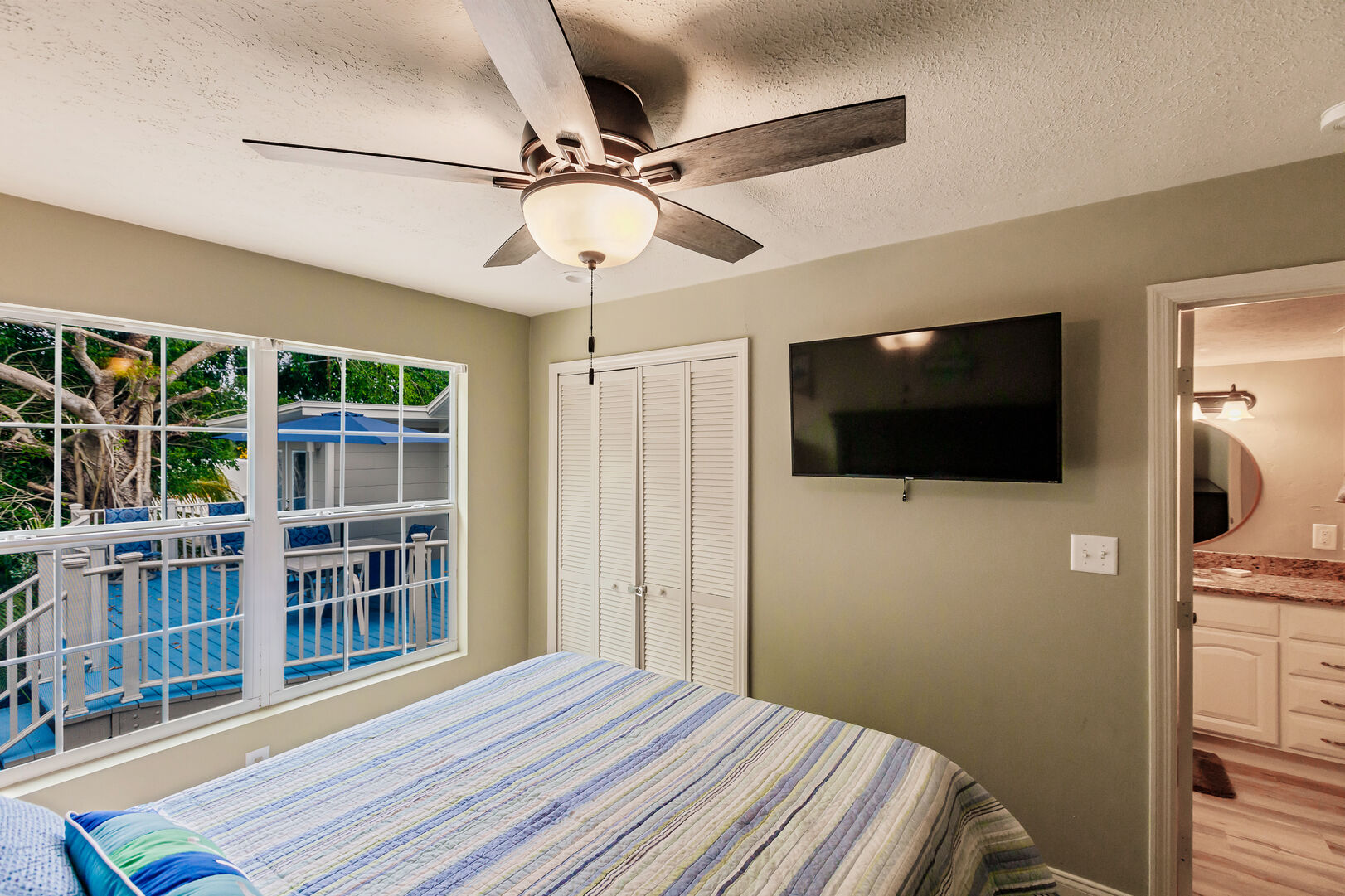 Beach Paradise Bedroom with View of Back Deck