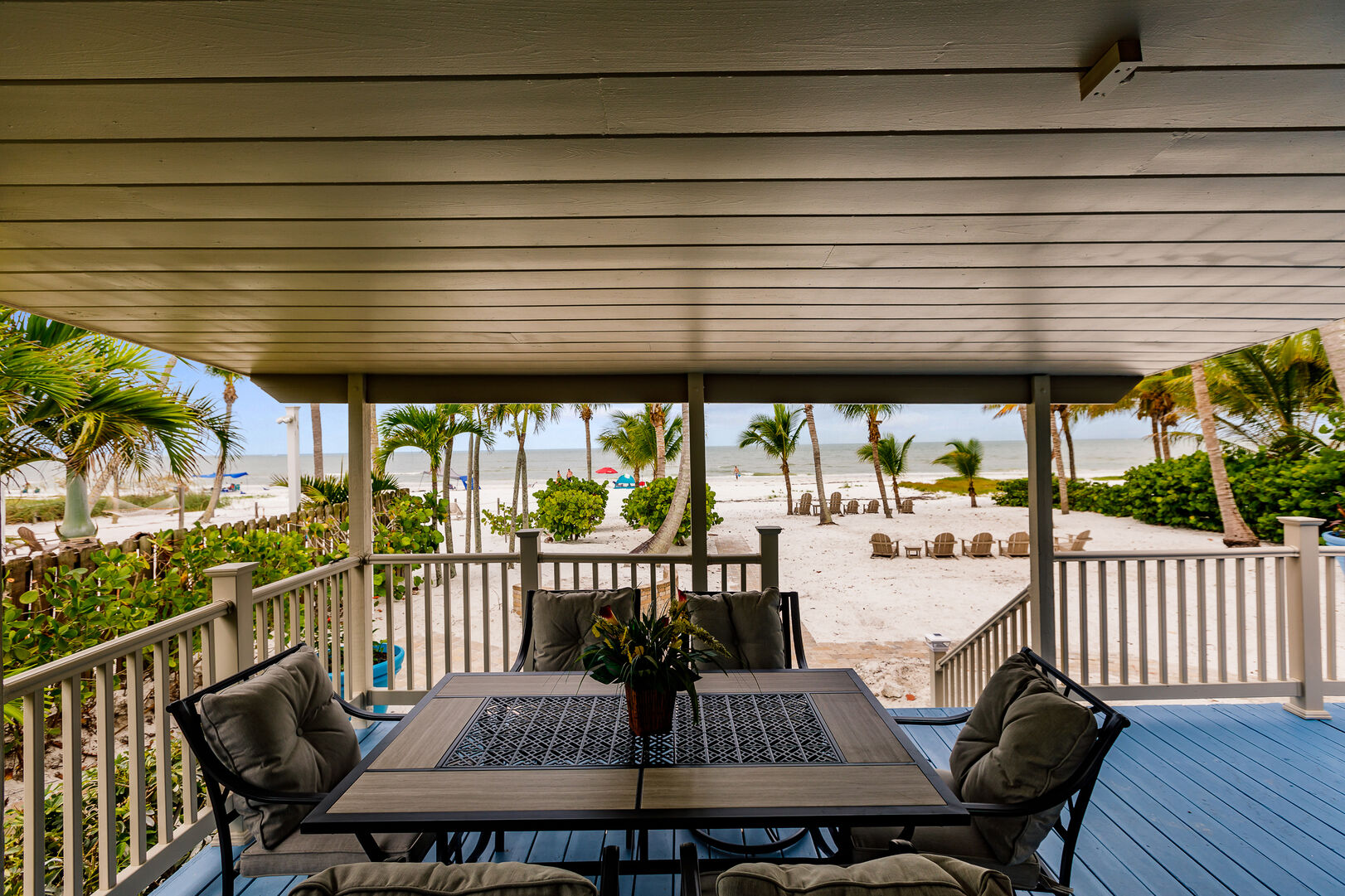 Beautiful Back Deck with Plenty of Seating and Beachfront View