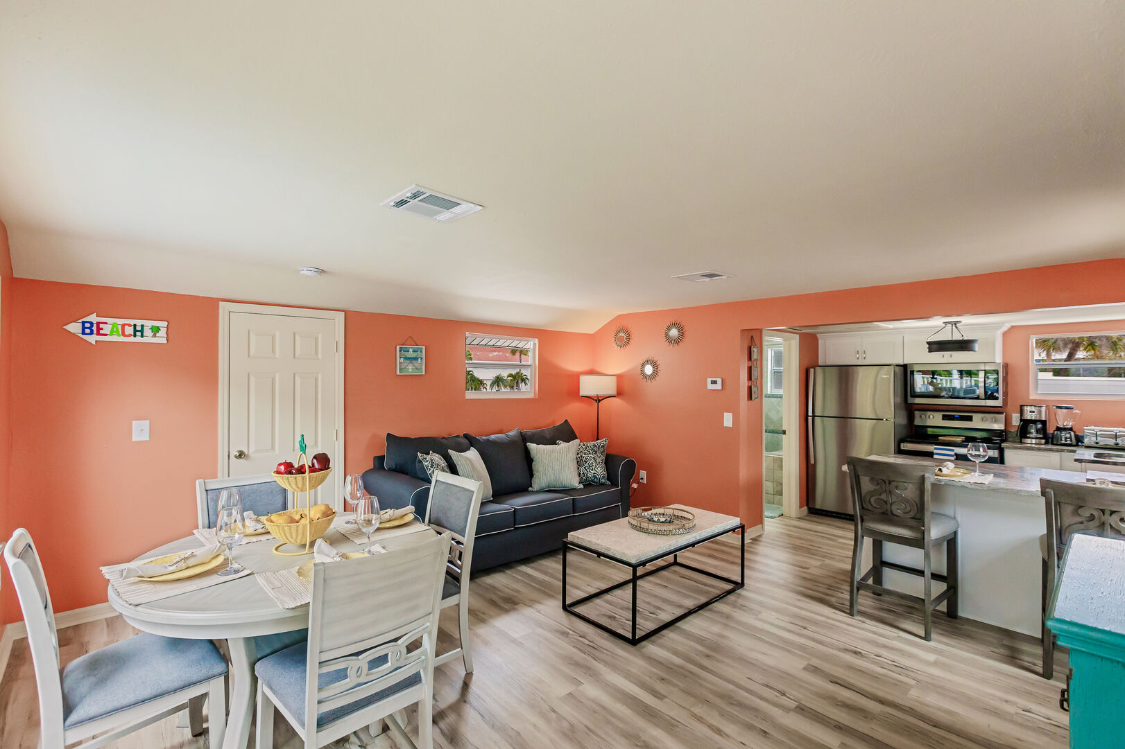 Coral Colored Living and Dining Area Fort Myers Beach House Vacation Rental