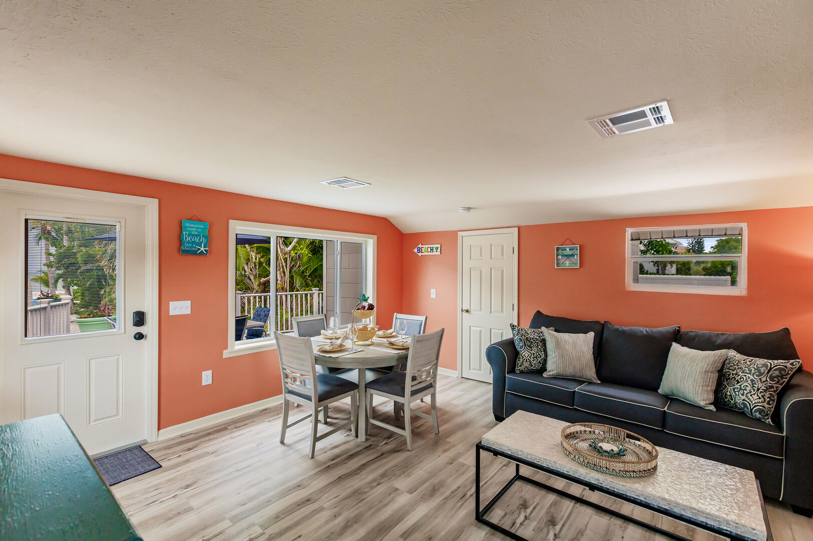 Coral Colored Living and Dining Space Stone Crab Cottage