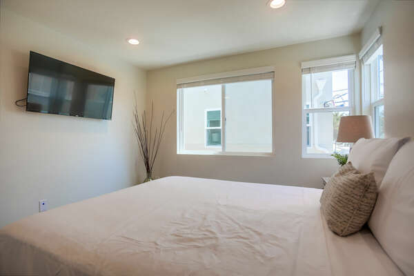 Second Floor Guest Bedroom with Queen Bed and TV