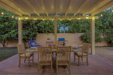 Extra shade is provided under the custom built pergola and party lights. This really sets the mood for a relaxing dinner.
