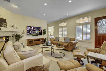You will be greeted by a large family room. This space features a 75-inch Sony Smart television and decorative fireplace