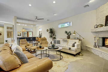 The open floor plan makes the living space, dinning area and  kitchen feel united.