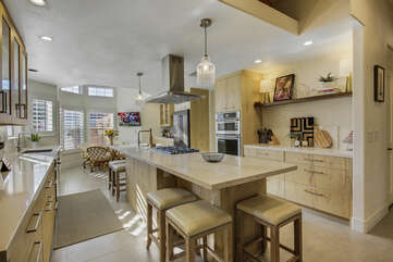 The fully-equipped kitchen features stunning stainless steel appliances and everything you would need to prepare your favorite homemade meals.