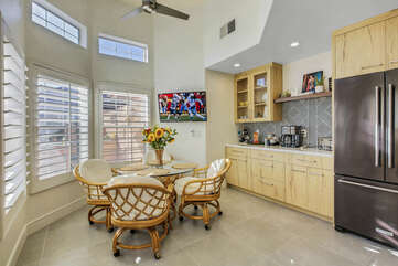 Enjoy your breakfast in the breakfast nook featuring a coffee station and a 42-inch LG Smart television.