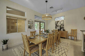 The dining room features a casual dining table with seating for 8-9, plenty of room for the whole family.