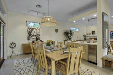 The dining room area features a beautiful mid-sized wet bar with seating for four.