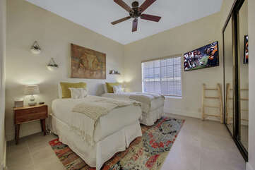 Suite 3 is located next to the laundry room and features two Twin-sized Beds,a 42-inch LG Smart television with a Roku stick and an adjoining, en suite bathroom.