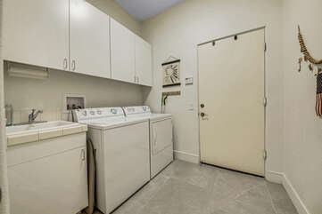 Fully equipped laundry room with washer, dryer, ironing board, and iron. Pro traveler tip: wash your clothes before you check-out, with Tide Pods provided by Vacay Stay. Arrive home with fresh clothes.