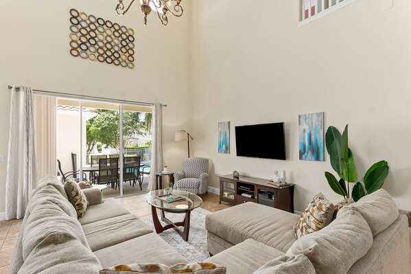 The living room features high ceilings, making the area feel very spacious.