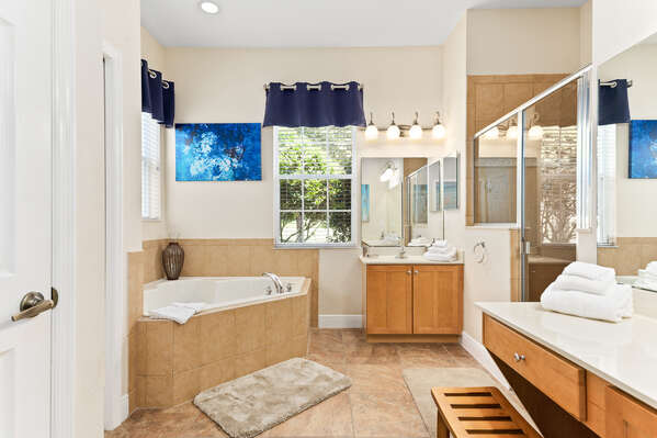 Get ready for the day or wind down at night in the spacious master bathroom.