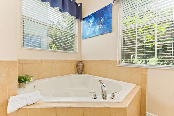 Relax in your stand-alone tub.