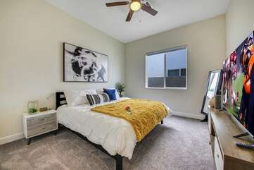 Bedroom 2 is located next to the master suite 1 and features a King-sized Bed and 50-inch HiSense Smart television.