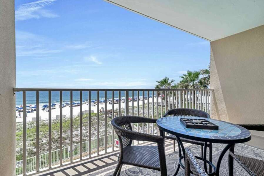 Private Balcony Overlooking the Beach and the Gulf with Dining Table for 4