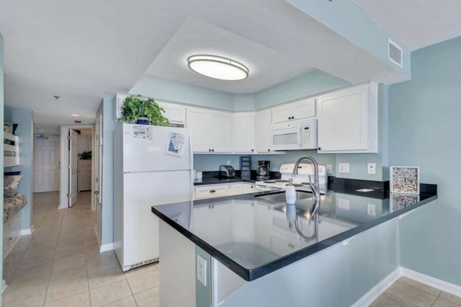 Beautifully Updated Kitchen with Granite Countertops and views of the Gulf