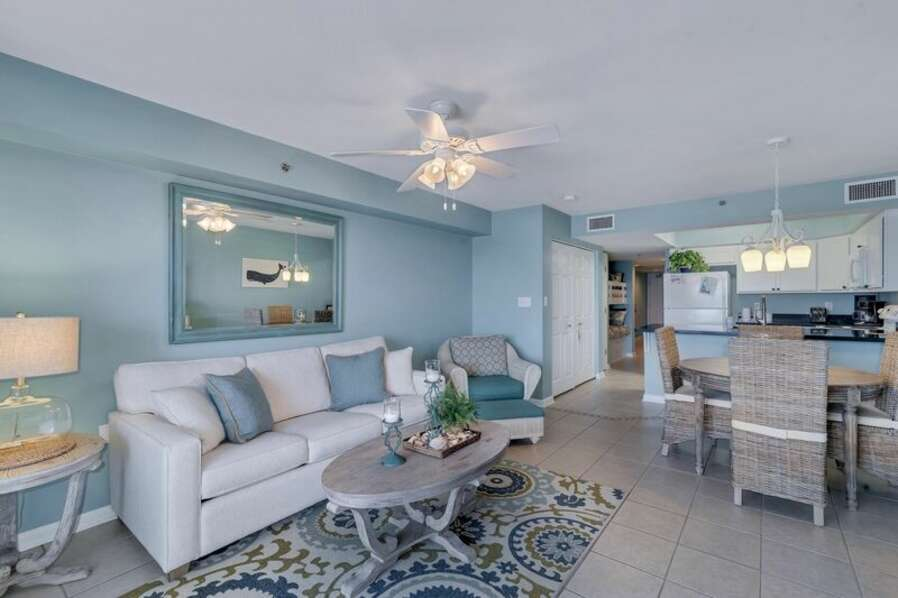 Spacious Living Area with views of the Beautiful Gulf of Mexico and access to Private Balcony and Full Size Sleeper Sofa