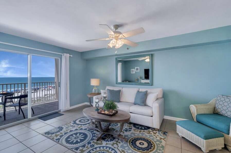 Spacious Living Room with views of the Beautiful Gulf of Mexico and access to Private Balcony and Full Size Sleeper Sofa