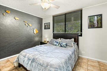 Bedroom with Large Bed and Ceiling Fan