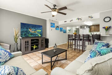Sofas, Smart TV, Ceiling Fan, and Breakfast Bar with Bar Stools