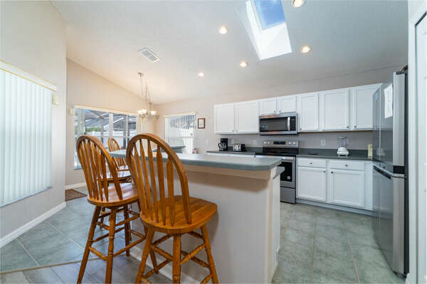 Kitchen has bar seating area for 4 people