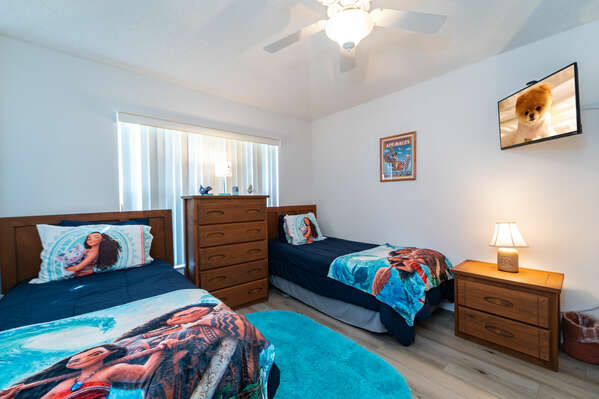 Bedroom 4 has twin beds and a Moana theme with wall mounted flatscreen TV