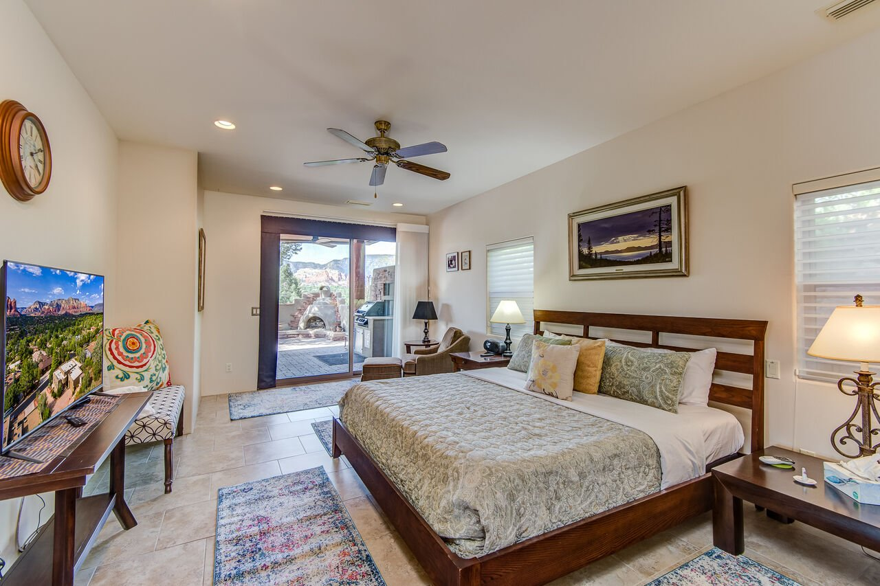 Main Level Master Bedroom with a King Bed, Private Bath, and Patio Access