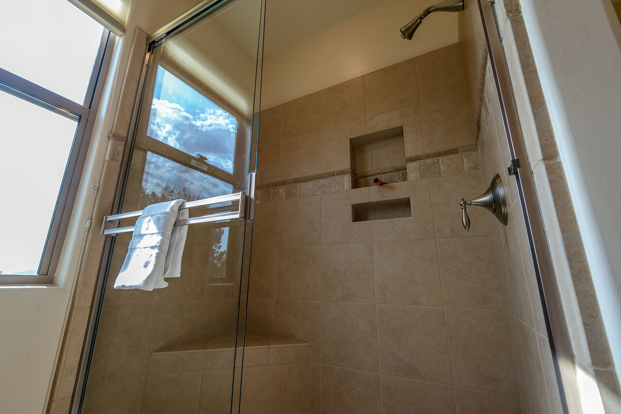 Master Bath 2 with a Tile and Glass Shower
