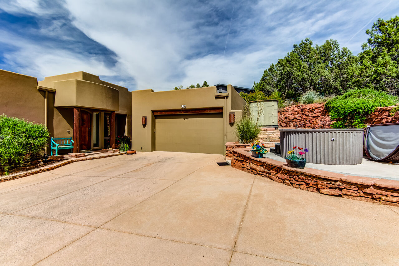 Space for One Car in the Garage and Ample Driveway Parking