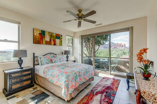 Main Level Master Bedroom 2 with a Queen Bed and Private Patio