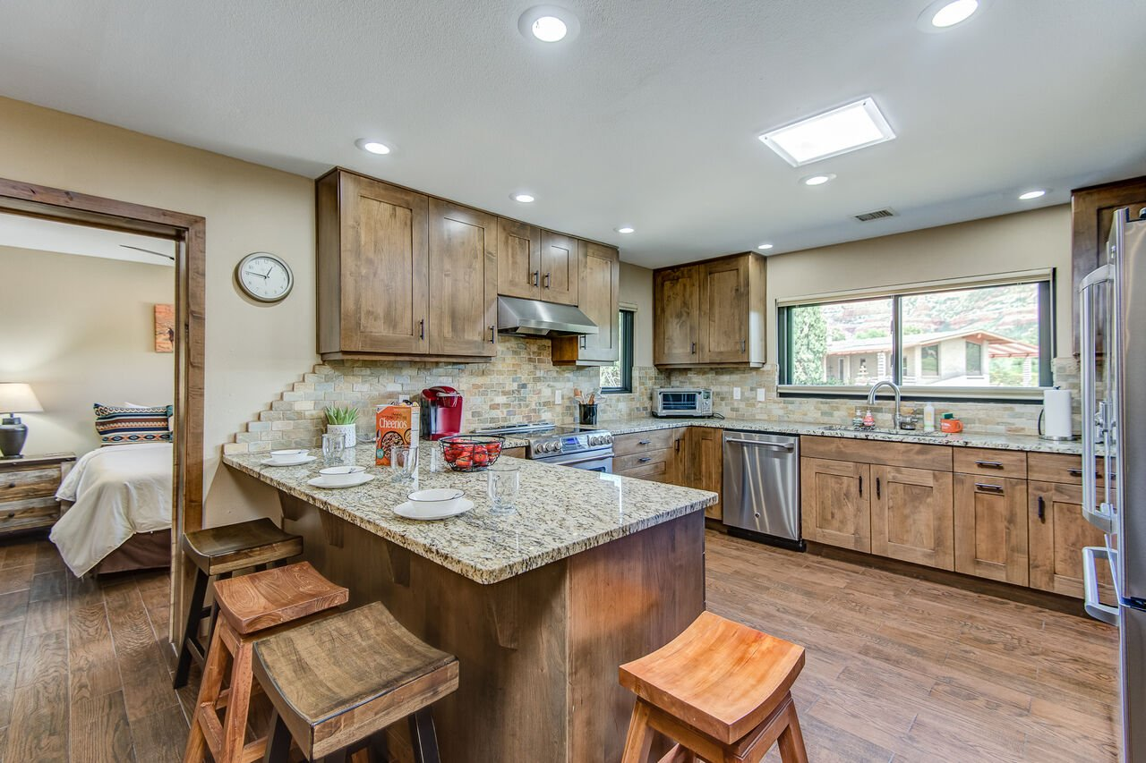 Gourmet Kitchen with Alder Cabinets and Granite Counters, and Bar Seating for Four