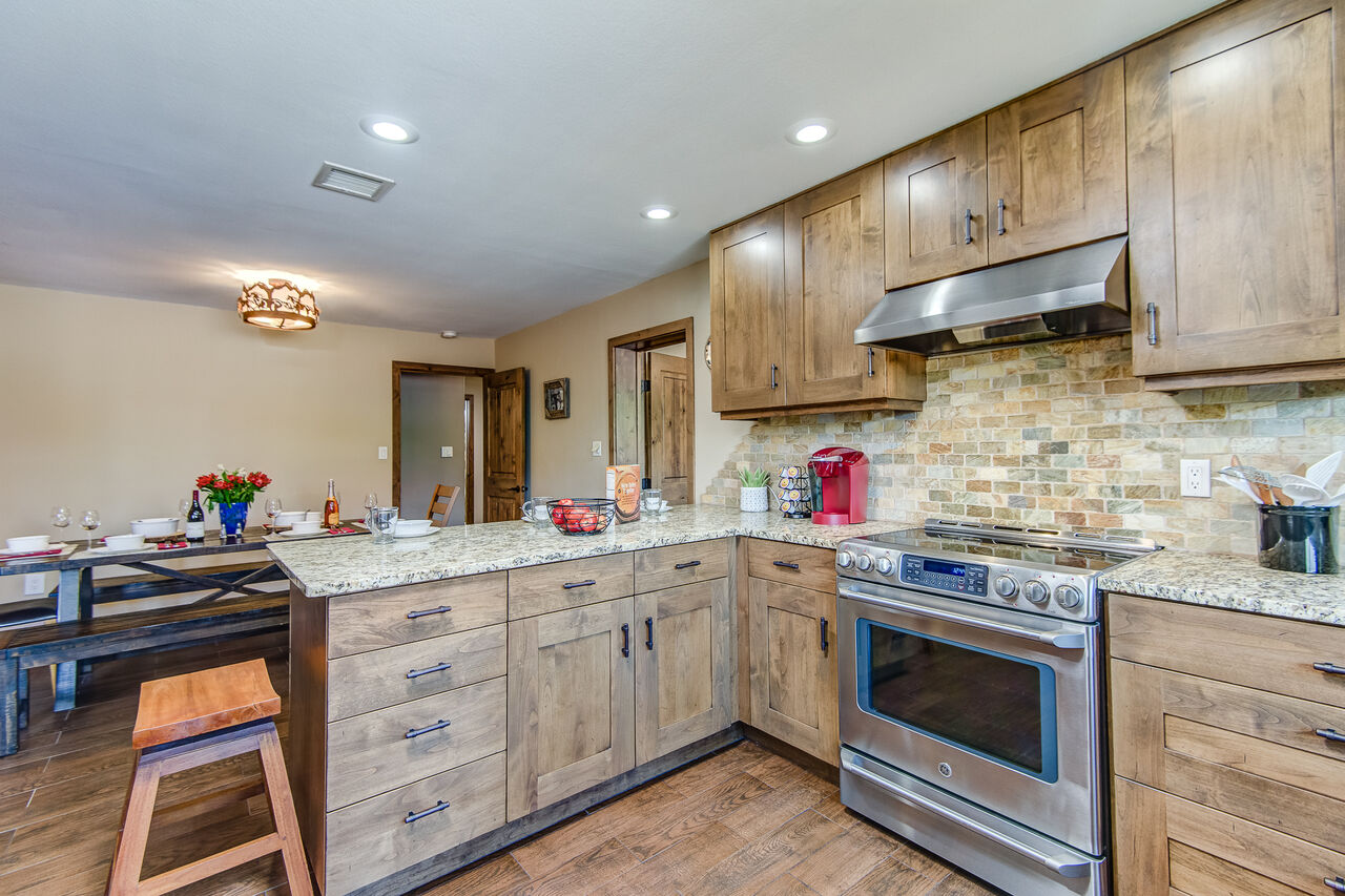 Chef's Kitchen with GE Cafe Series Stainless  Steel Appliances, Including a 5-Burner Electric Range