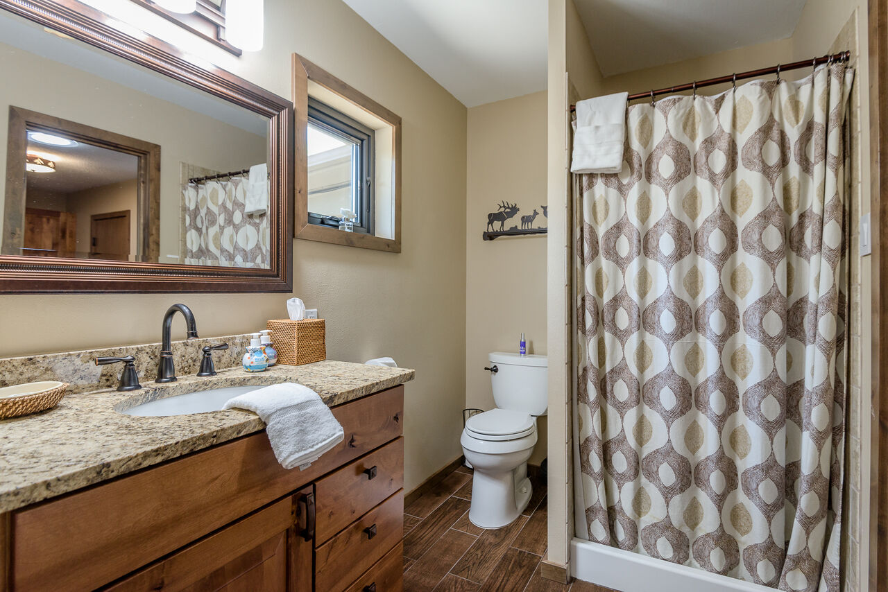 Master Bath 2 with a Granite Counter Sink and Shower