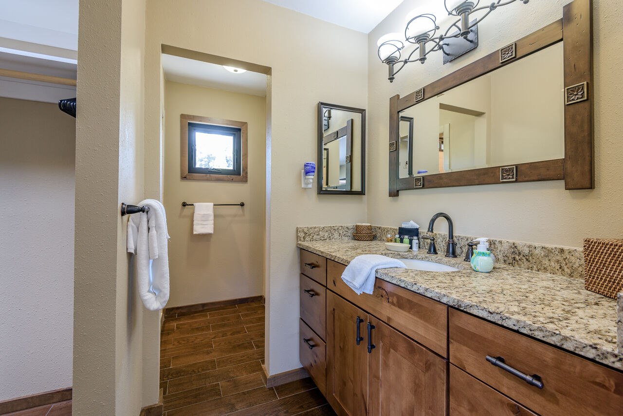 Grand Master Bath with a Granite Counter Sink and Separate Shower