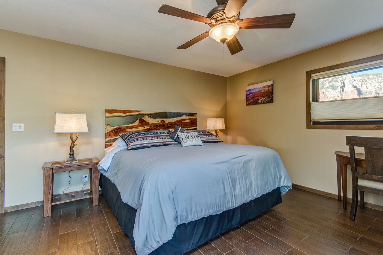 Grand Master Bedroom with a King Bed and Desk if You Need to Catch Up on Some Work