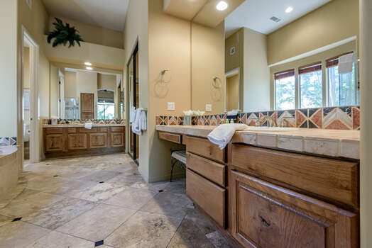 Huge Master Bath with Separate Vanities and a Make-up Area