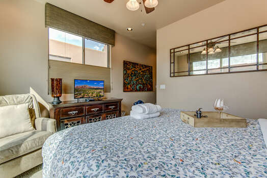 Master Bedroom with a TV, Walk-in Closet, and Private Bath