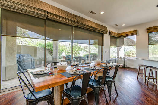 Dining Area with Seating for Eight That Opens to the Backyard