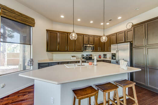 Fully Equipped Kitchen with  Island Seating for Three