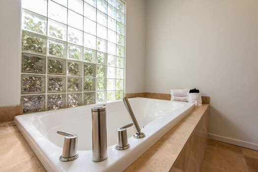 Grand Master Bath with a Large Soaking Tub with a Handheld Shower Head