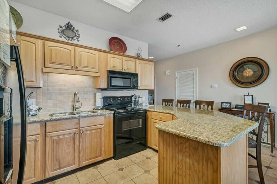 Large Size Kitchen complete with a Breakfast Bar and Granite Countertops