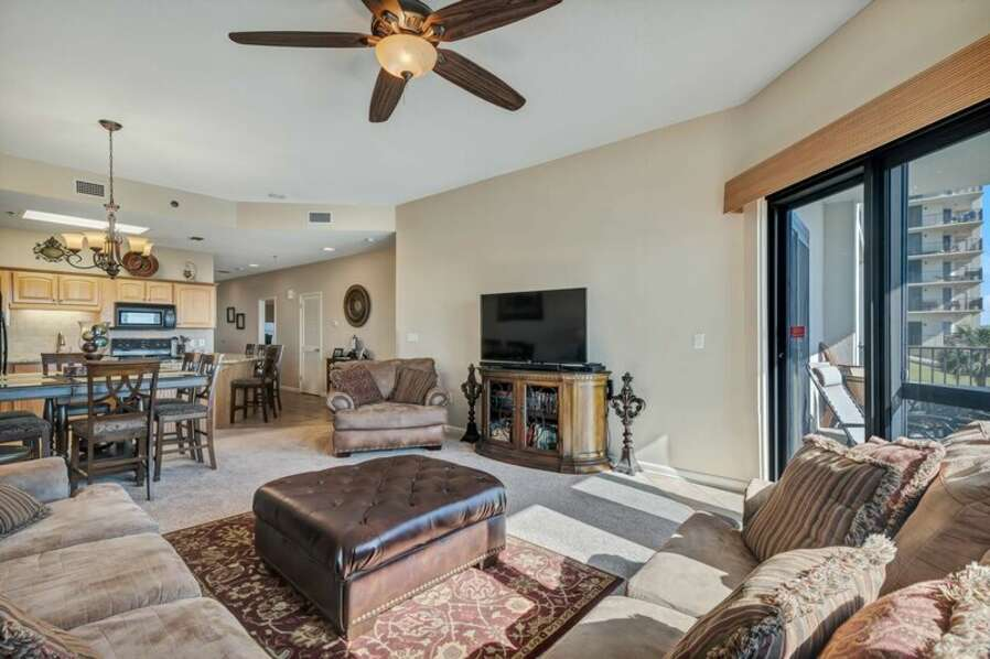 Spacious Living Room with Plenty of comfortable seating and Beachfront Private Balcony