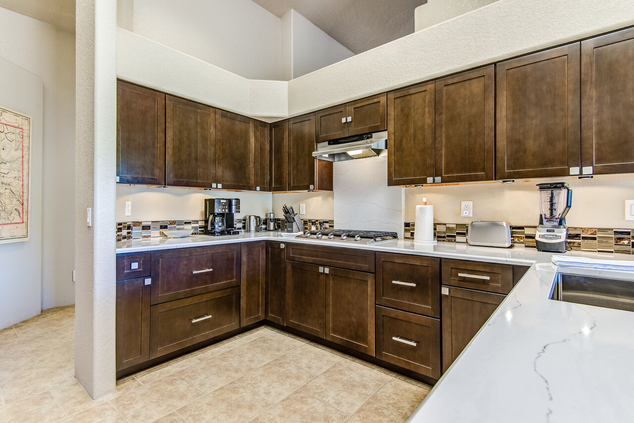 Fully Equipped Kitchen with Stainless Steel Appliances and Stone Counters